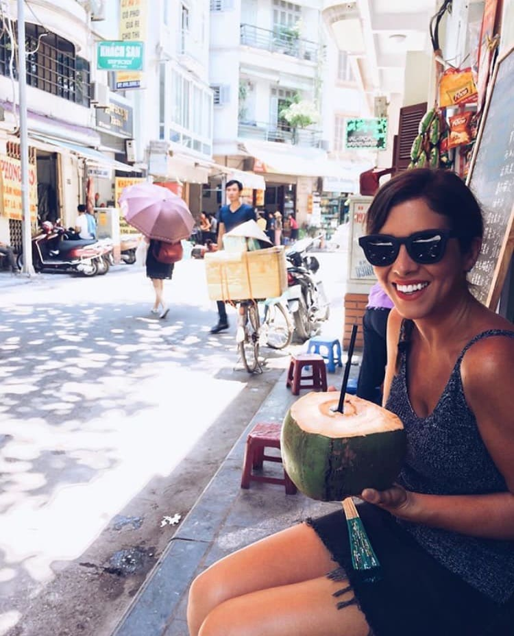 @alexandra_watson in vietnam sippin on coconut water